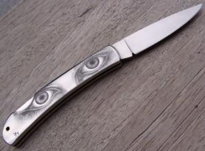 Bulino engraving on Stainless steel folding knife handle 1