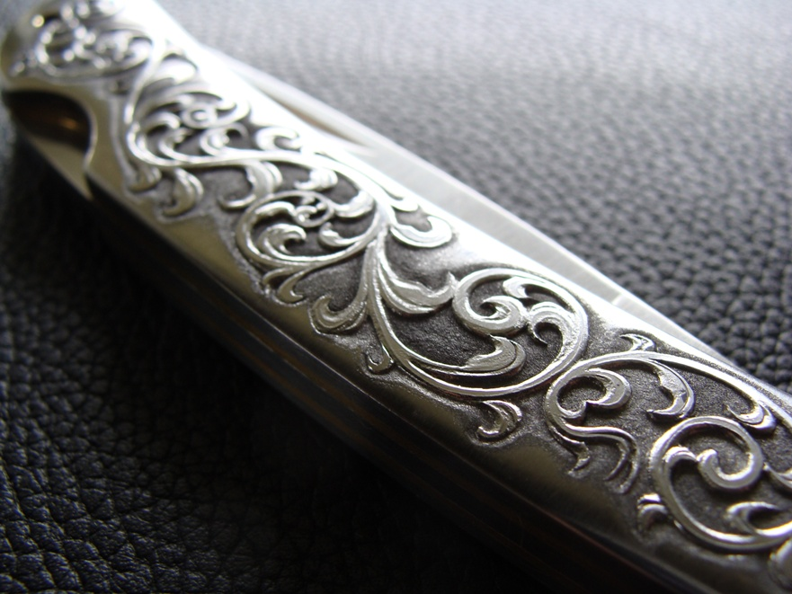 Custom knife relief engraving