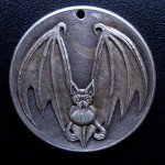 'Bat' carveing in a silver USA 1964 (Kennedy silver half $) 1c