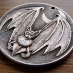 'Bat' carveing in a silver USA 1964 (Kennedy silver half $) 3