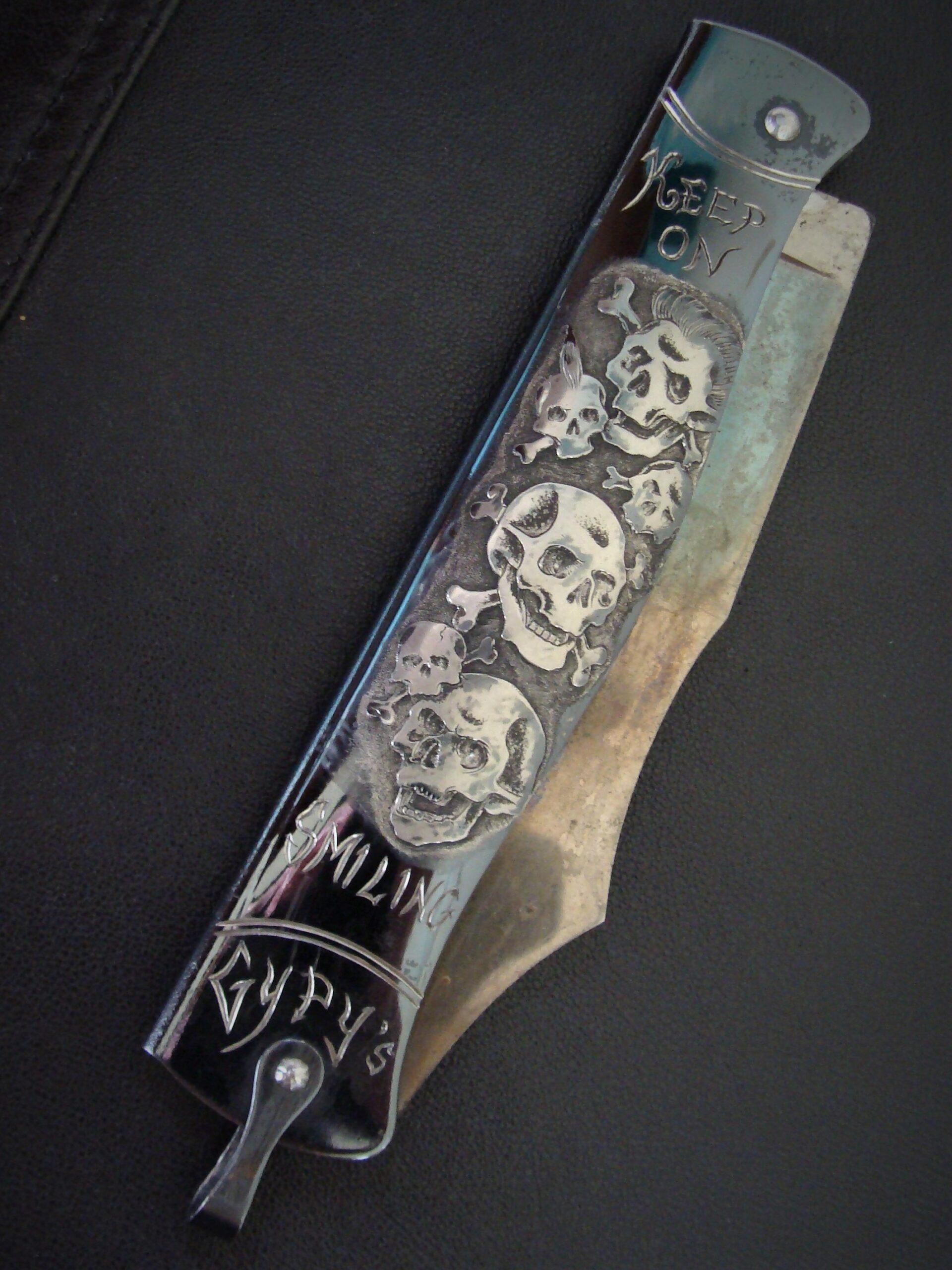 'Keep On Smiling' skulls, pocket knife engraving.