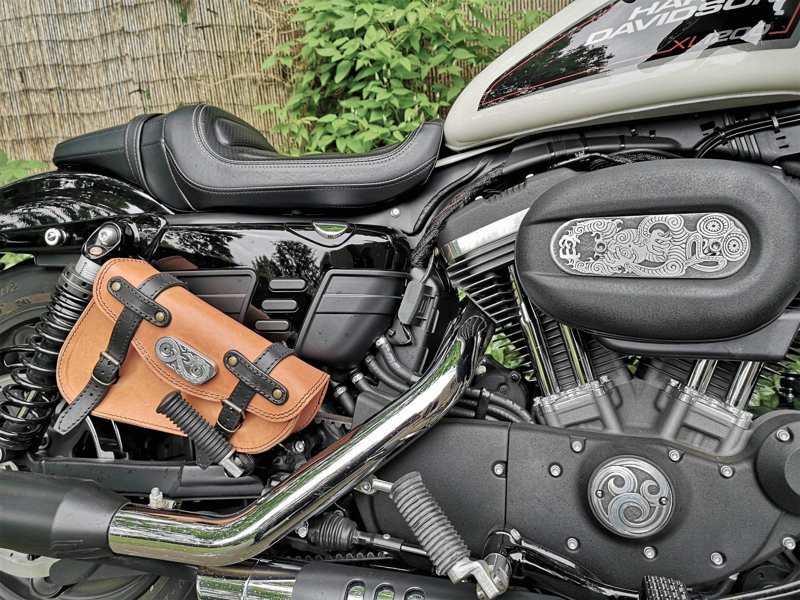 Maori inspired, hand engraved parts on a Harley-Davidson Sportster 1200 Roadster.