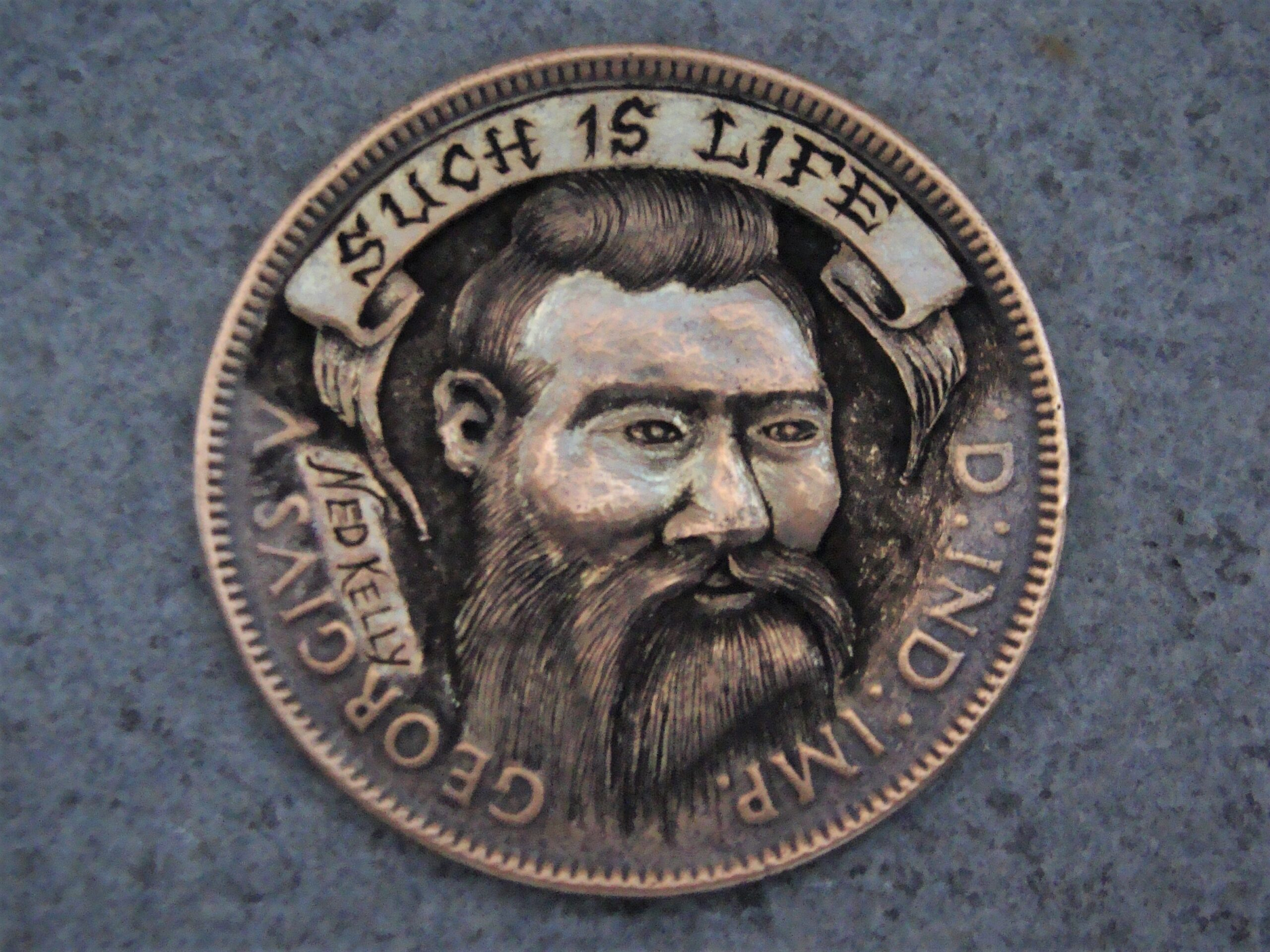 'Such Is Life', Ned Kelly coin carving.
